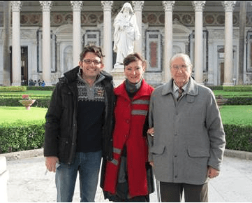 Viviana's dad, her husband and her outside Saint Paul Basilicate in Rome.