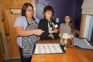Holly Costa with her children, Jacob and Isabella, baking cookies