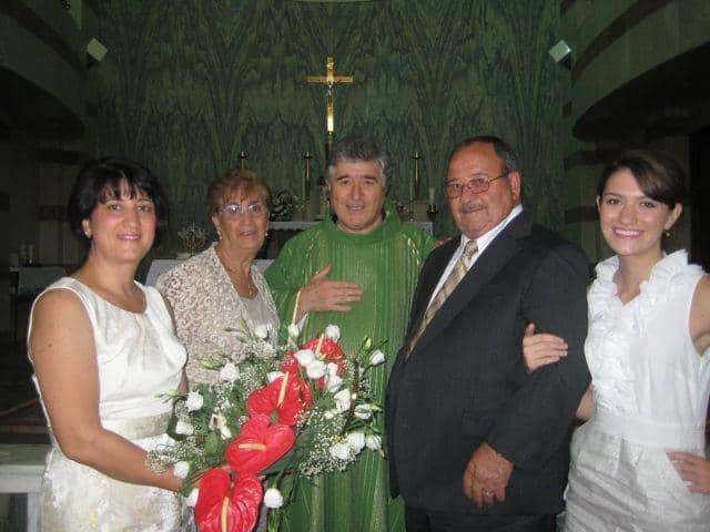 Celebrating the 50th Wedding Anniversary of her grandparents in Ateleta, Italy (L to R: Mother, Sandy Colaizzi - Grandmother, Irma Colaizzi (Priest from Ateleta), Grandfather, Elio Colaizzi, Tinamaria Colaizzi