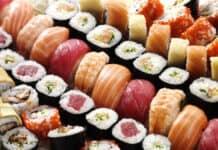 many tasty fresh japanese sushi with white rise red tuna caviar orange shrimp